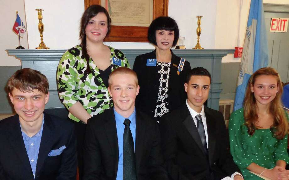 """Recipients of the annual """"Good Citizen Award"""" from the Eunice Dennie Burr Chapter of the Daughters of the American Revolution are, front row from left: Christoph Dow of Joel Barlow High School in Redding, Charles Fallon of Notre Dame High School, Jairo Martinez of Fairfield College Preparatory School and Brigitte Dale of Fairfield Ludlowe High School. Standing are Lena and Linda Paslov, the program co-chairwomen. Photo: Contributed Photo / Fairfield Citizen"""