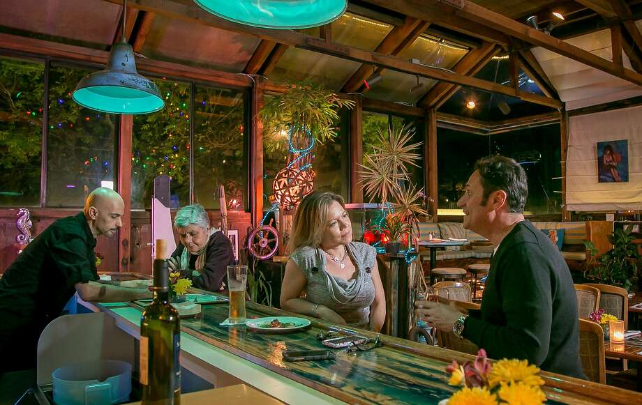Clockwise, from above: During the week from 4 to 7 p.m. Sausalito Seahorse restaurant offers happy hour specials like complimentary bruschetta; the grilled seafood salad is paired with Greco di Tufo white wine; and Keiko Bakter (left) and Eloy Rivera dance during Sunday night salsa. Photo: John Storey, Special To The Chronicle