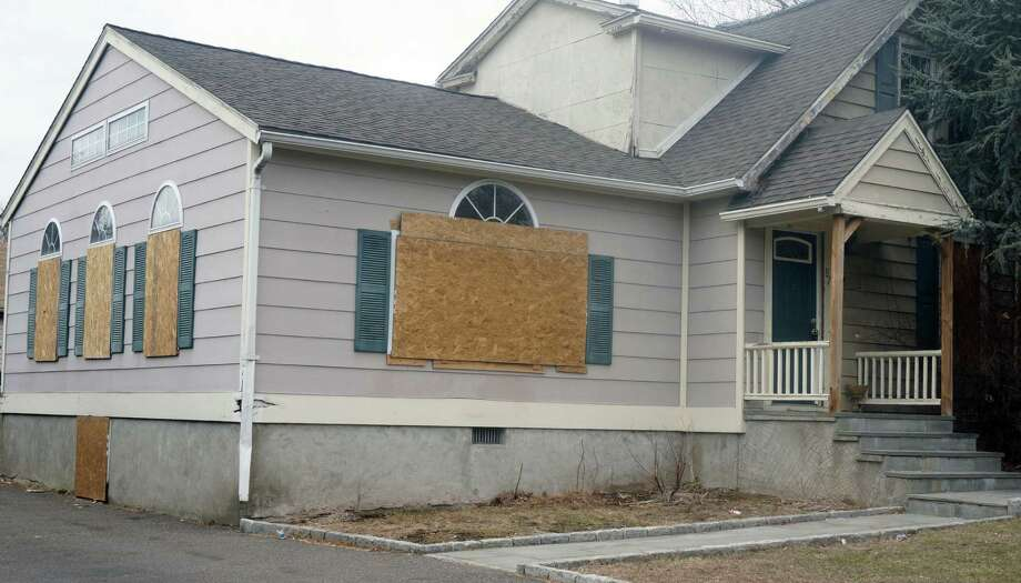 This home on Black Rock Avenue has been the target of vandals, who have even taken the kitchen sink. Photo: Genevieve Reilly / Fairfield Citizen