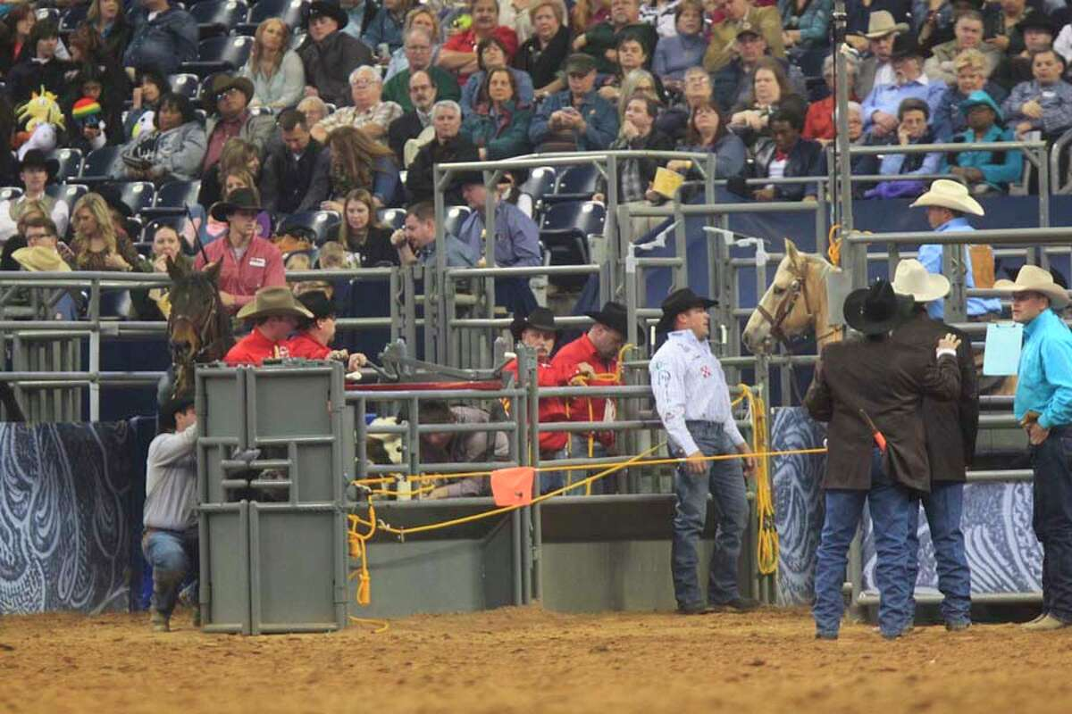 Juan Alcazar participates in the Steer Wrestling event during Rodeo Houston at the Houston Livestock Show and Rodeo at Reliant Stadium Thursday, March 6, 2014, in Houston. ( Johnny Hanson / Houston Chronicle )