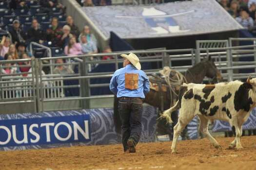 Juan Alcazar participates in the Steer Wrestling event during Rodeo Houston at the Houston Livestock Show and Rodeo at Reliant Stadium Thursday, March 6, 2014, in Houston. ( Johnny Hanson / Houston Chronicle ) Photo: Johnny Hanson, Houston Chronicle / © 2014  Houston Chronicle