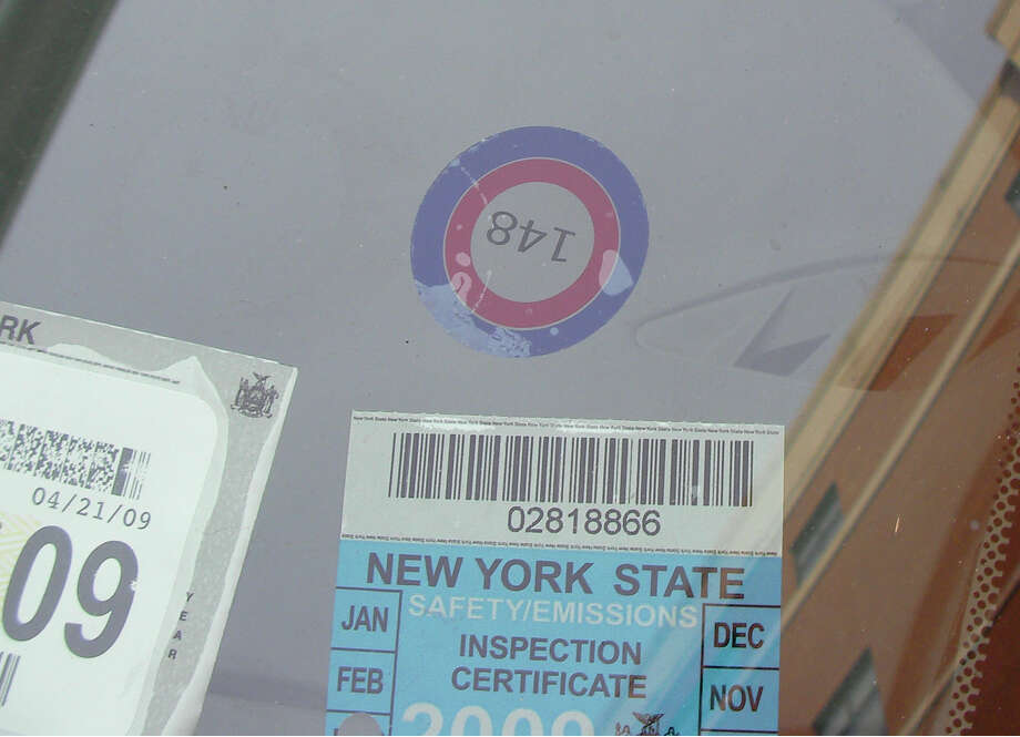 These ''bulls-eye'' stickers alerted parking enforcement officers in Albany that the car may be connected to a police officer and should not receive a ticket that carries any fine.  Read the story. Photo: ALL