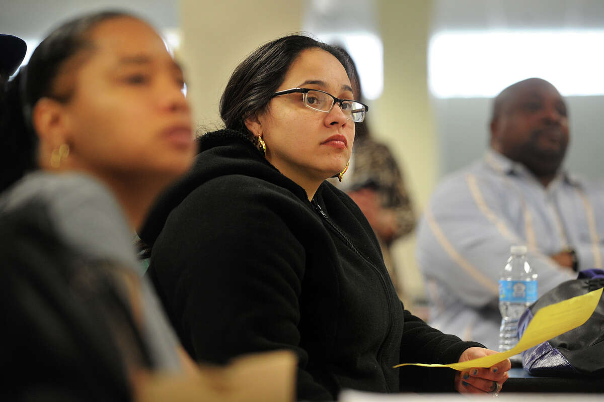 From left; Parents Susan Harrison and Justine Fernandez attend a community forum to discuss a Commissioner's Network turnaround plan at Luis Munoz Marin School in Bridgeport, Conn. on Wednesday, March 19, 2014.