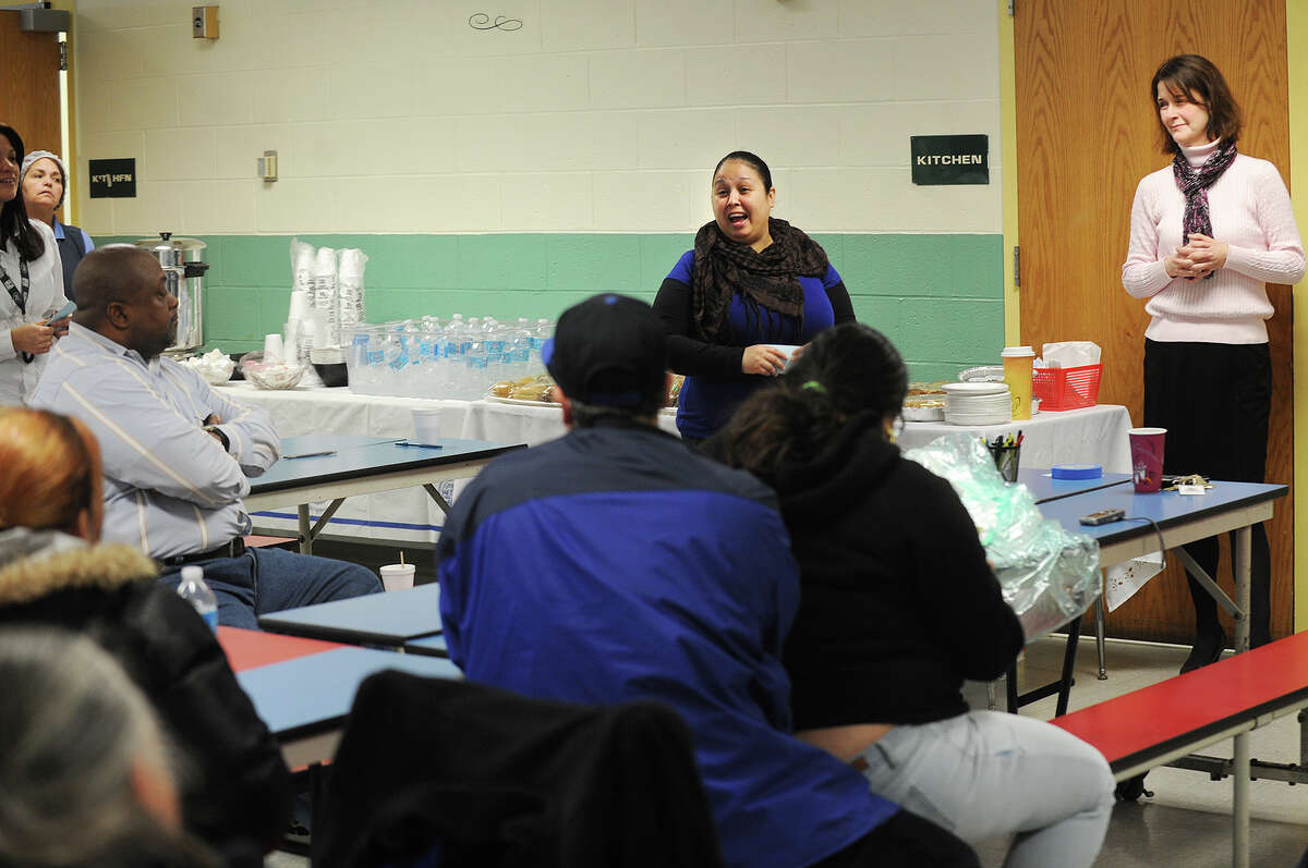 Turnaround committee members Rosa Torres, left, and Jackie Colantonio, address school parents at a community forum to discuss a Commissioner's Network turnaround plan at Luis Munoz Marin School in Bridgeport, Conn. on Wednesday, March 19, 2014.