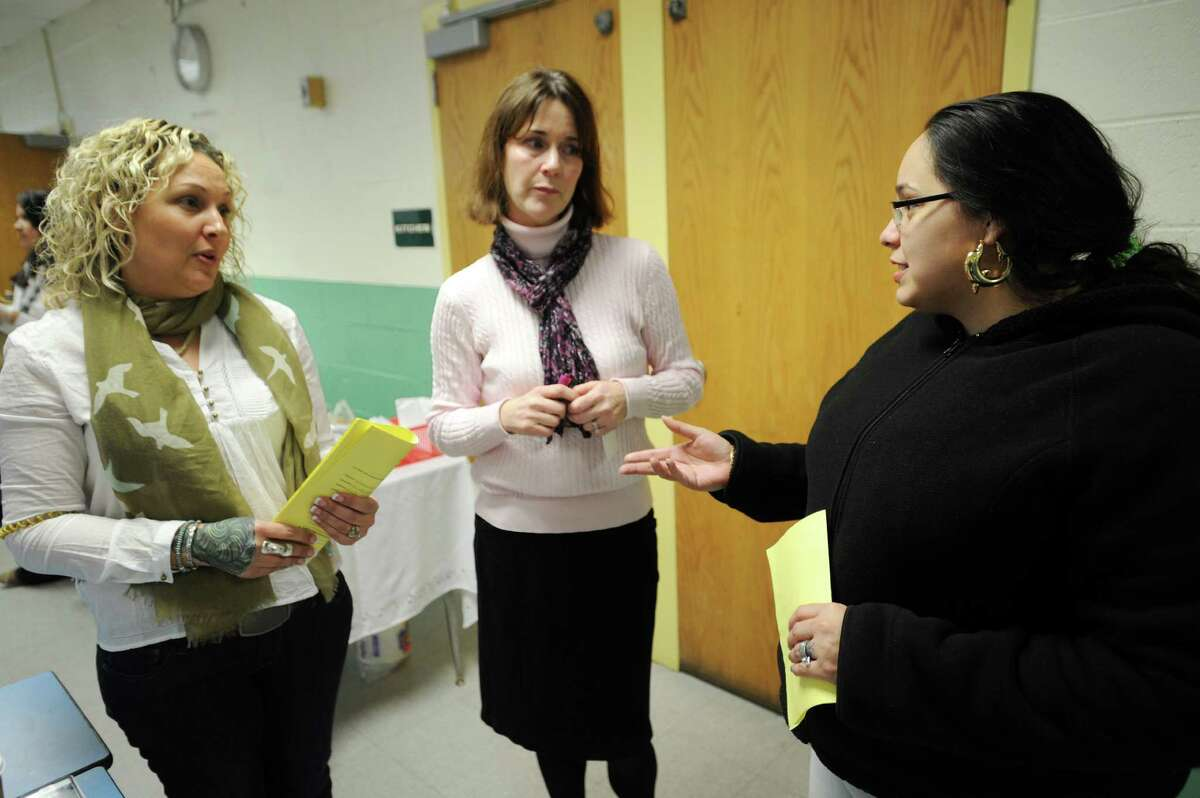 From left; Marin PAC President Catalina Acevedo, turnaround committee member and Marin ESL teacher Jackie Colantonio, and parent Justine Fernandez chat following a community forum to discuss a Commissioner's Network turnaround plan at Luis Munoz Marin School in Bridgeport, Conn. on Wednesday, March 19, 2014.