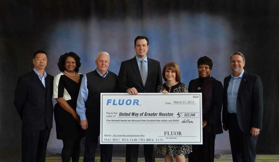 13. Fluor (ranked No. 146 in the U.S.)Brand rating: AAValue in 2014: $3.77billionSource: BrandDirectory.comPictured: Fluor Corporation presented a check for more than $522,000 to United Way of Greater Houston's President and CEO Anna M. Babin, along with Sugar Land Mayor James Thompson. Photo: United Way Of Greater Houston