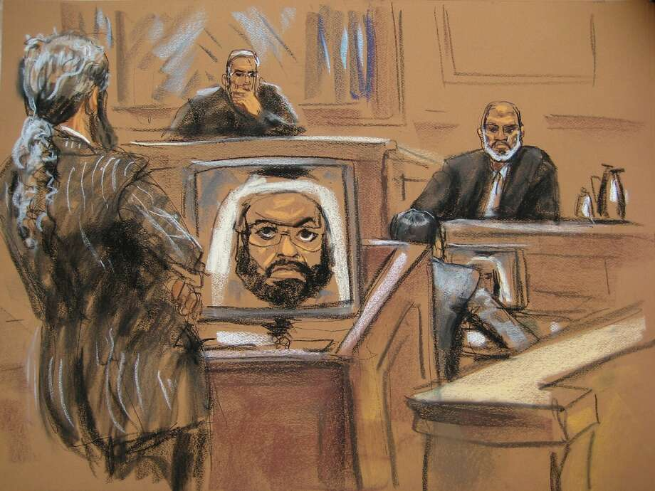 Osama bin Laden's son-in-law Suleiman Abu Ghaith (R) is seen in a courtroom drawing as he takes the stand in his own defense against terrorism charges in federal court in New York March 19, 2014.  Abu Ghaith, a former al Qaeda spokesman, is one of the highest profile people to face terrorism-related charges in a civilian court in the United States.  Abu Ghaith's lawyer Stanley Cohen is seen on the left, an image of accused September 11 attack mastermind Khalid Sheikh Mohammed appears on a monitor in the center, and U.S. District Judge Lewis Kaplan is seated at the bench.  REUTERS/Jane Rosenberg  (UNITED STATES - Tags: CRIME LAW POLITICS) NO SALES. NO ARCHIVES. FOR EDITORIAL USE ONLY. NOT FOR SALE FOR MARKETING OR ADVERTISING CAMPAIGNS. THIS IMAGE HAS BEEN SUPPLIED BY A THIRD PARTY. IT IS DISTRIBUTED, EXACTLY AS RECEIVED BY REUTERS, AS A SERVICE TO CLIENTS Photo: Jane Rosenberg, Reuters