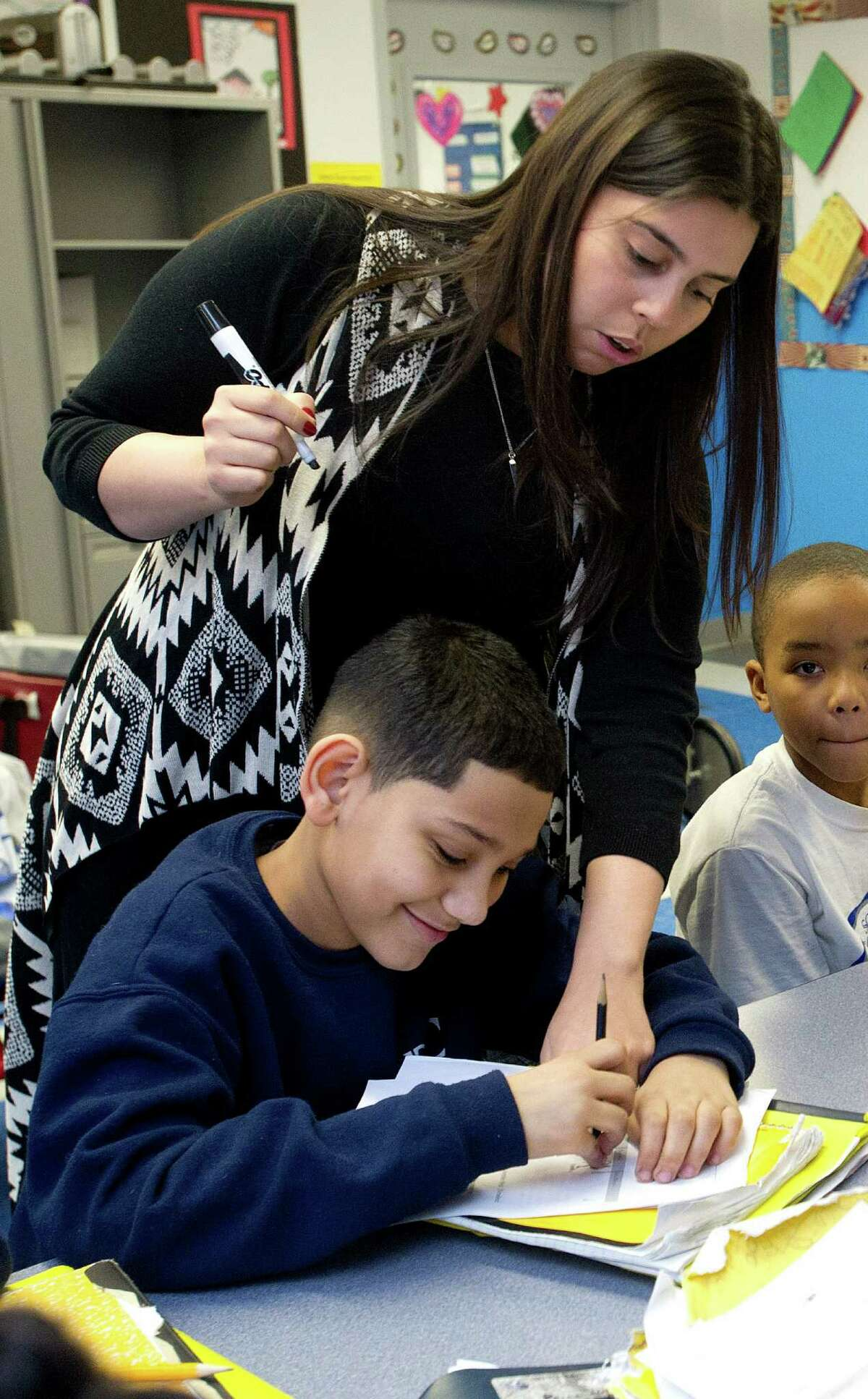 Arleen Rodriguez teaches math at Bronx Charter School for Excellence in New York on Thursday, March 6, 2014. The school has filed an application to open Stamford Charter School for Excellence in 2015.