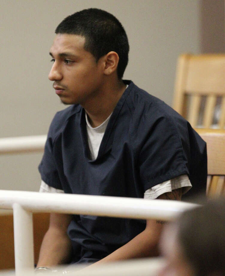 John Anthony Rubio, 16, sits in the 486th District Court Friday September 13, 2013. Rubio was arrested along with two adults after a robbery took place yesterday morning at a Valero Corner Store and another man was shot and killed at a nearby apartment complex on the 10,400 block of Huebner Road. Photo: JOHN DAVENPORT, SAN ANTONIO EXPRESS-NEWS / ©San Antonio Express-News/Photo may be sold to the public