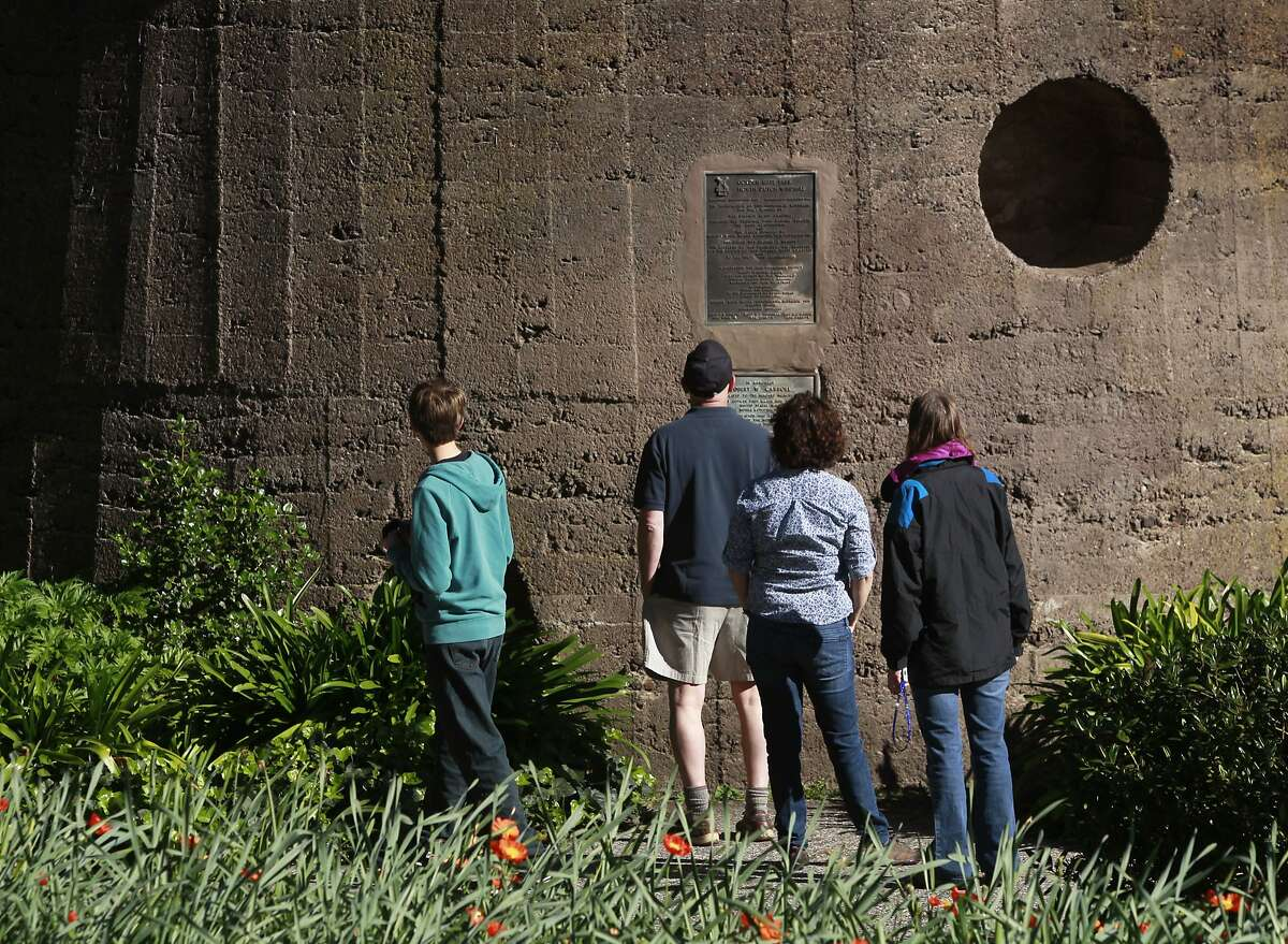 Visitors pause to read plaques at the base of the Dutch windmill at Golden Gate Park in San Francisco, Calif. on Wednesday, March 19, 2014. More funding is needed to renovate the windmill located on the northwest corner of the park.