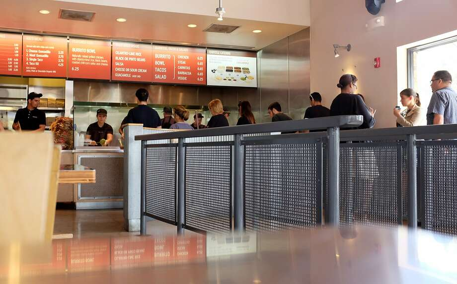 After fighting upstream against a horde of people outside Yerba Buena, you have to stand in a massive line at Chipotle. And you start wondering why you didn't bring lunch today. Photo: Joe Raedle, Getty Images