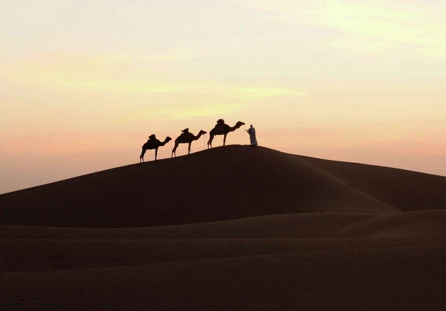 A one-man camel caravan stops at Mhamid el-Ghizlane in the Moroccan southern Sahara Desert. Photo: FADEL SENNA / AFP/Getty Images / AFP