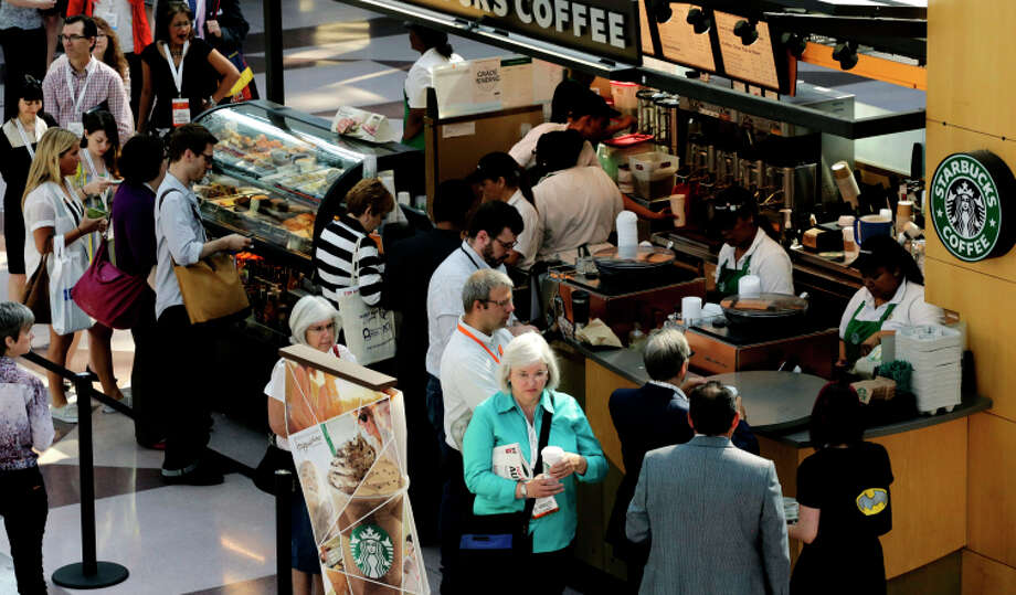 Line like these at a New York Starbucks last year could disappear with the advent of delivery. Photo: Mark Lennihan / Associated Press / AP