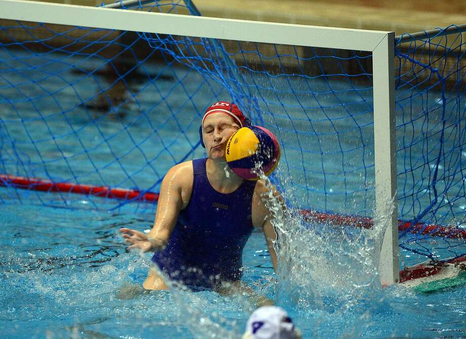 Look ma, no hands: Italy goalkeeper Giulia Gorlero makes a save with her face during a World League match against Hungary in Budapest. Photo: Attila Kisbenedek, AFP/Getty Images