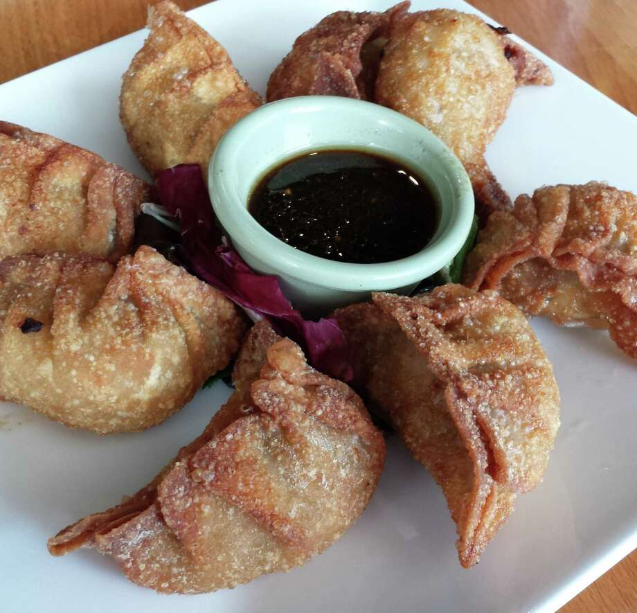 Minced Beef Mandu is an appetizer of handmade dumplings. Photo: Jennifer McInnis / San Antonio Express-News