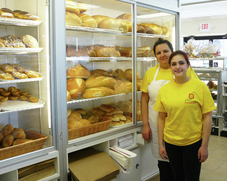 Marlene Chaves, left, and Fairfield Warde High School senior Faith Spardo, stand ready to help customers with their purchases of baked goods at the new Chaves Bakery, 401 King's Highway, in Fairfield. Photo: Staff Photo/Gretchen Webster / Fairfield Citizen