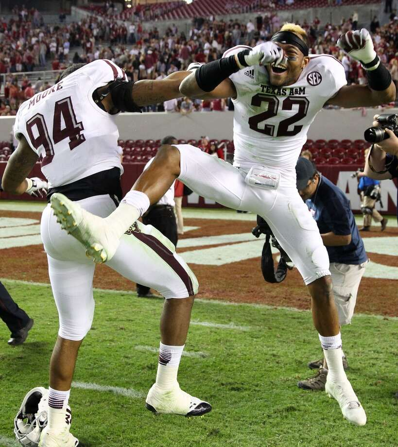Defensive back Dustin Harris #22 of the Texas A&M Aggies (right) celebrates with defensive lineman and teammate Demontre Moore #94 after the game against the Texas A&M Aggies at Bryant-Denny Stadium on November 10, 2012 in Tuscaloosa, Alabama.  (Photo by Mike Zarrilli/Getty Images) Photo: Mike Zarrilli, Getty Images