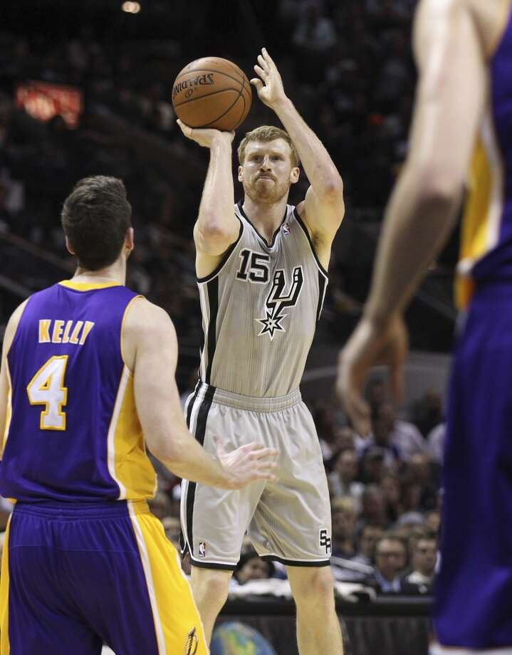 Spurs' Matt Bonner (15) takes a shot against Los Angeles Lakers' Ryan Kelly (04) in the first half at the AT&T Center on Friday, March 14, 2014. Photo: Kin Man Hui, San Antonio Express-News
