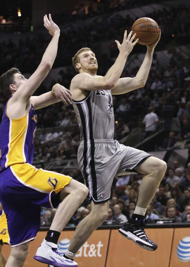 Spurs' Matt Bonner (15) drives to the basket against Los Angeles Lakers' Ryan Kelly (04) in the second half at the AT&T Center on Friday, March 14, 2014. Photo: Kin Man Hui, San Antonio Express-News