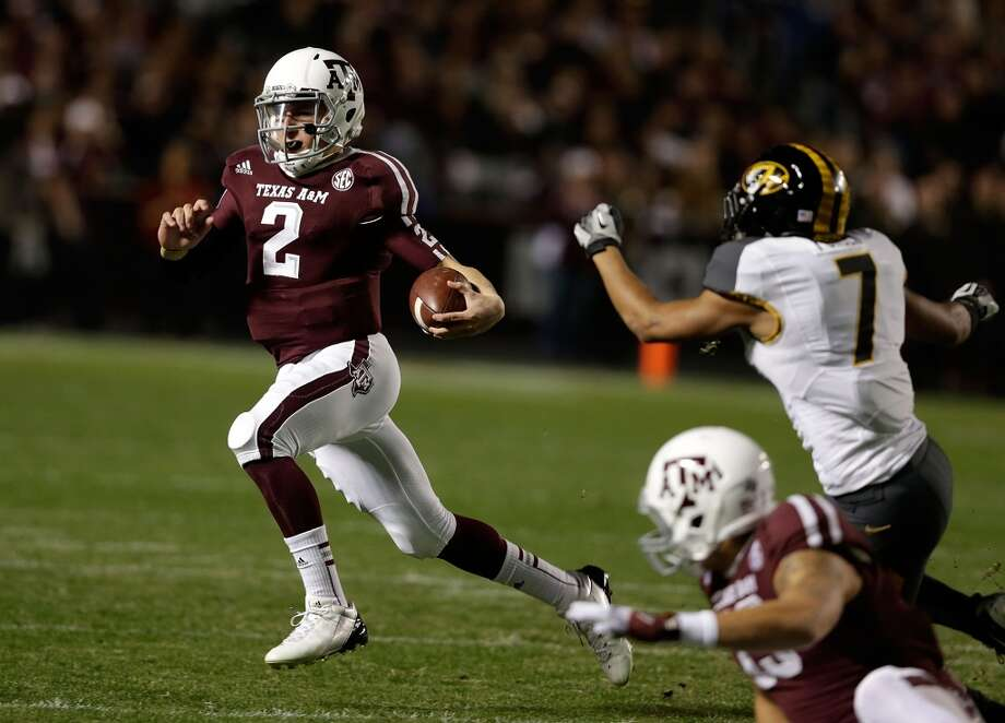 Texas A&M Aggies quarterback Johnny Manziel #2 rushes for a gain during their game against the Missouri Tigers at Kyle Field on November 24, 2012 in College Station, Texas.  (Photo by Scott Halleran/Getty Images) Photo: Scott Halleran, Getty Images