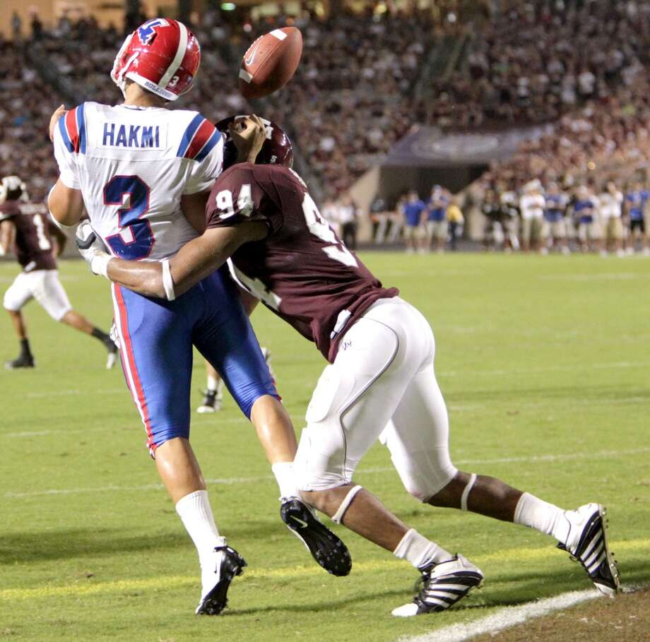 Louisiana Tech Bulldogs quarterback Tarik Hakmi (3) gets the ball knocked out by Texas A&M Aggies defensive tackle Damontre Moore (94) in side the Louisiana Tech end zone in the third quarter of an NCAA football game between Texas A&M and Louisiana Tech on Saturday, Sept. 11, 2010, in College Station. Louisiana Tech Bulldogs recovered the ball on the play. ( Julio Cortez / Houston Chronicle ) Photo: Julio Cortez, Chronicle