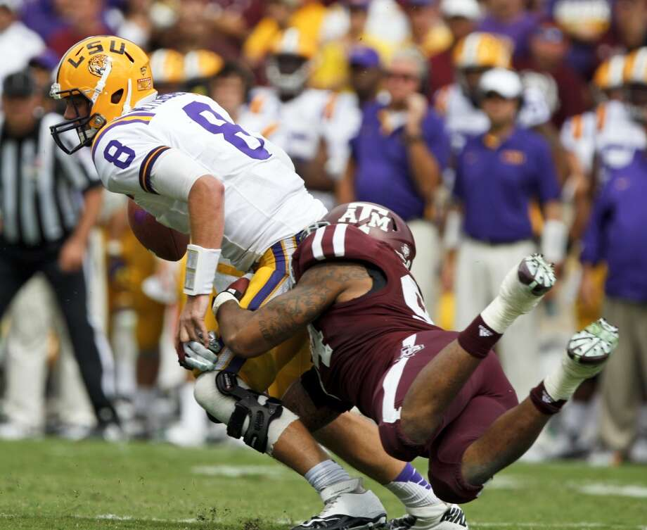 Texas A&M defensive lineman Damontre Moore (94) tries to tackle LSU quarterback Zach Mettenberger (8) during the second half of an NCAA college football game, Saturday, Oct. 20, 2012, in College Station, Texas. LSU won 24-19. (AP Photo/Eric Kayne) Photo: Eric Kayne, Associated Press