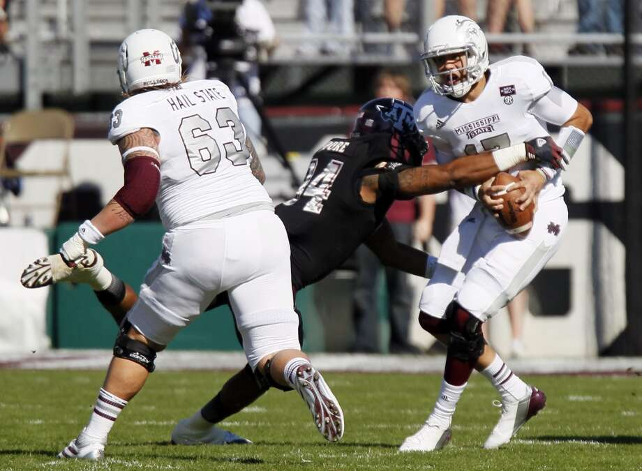 Texas A&M's Damontre Moore sacks Mississippi State's Tyler Russell in front of Dillon Day (63). Photo: Rogelio V. Solis, Associated Press