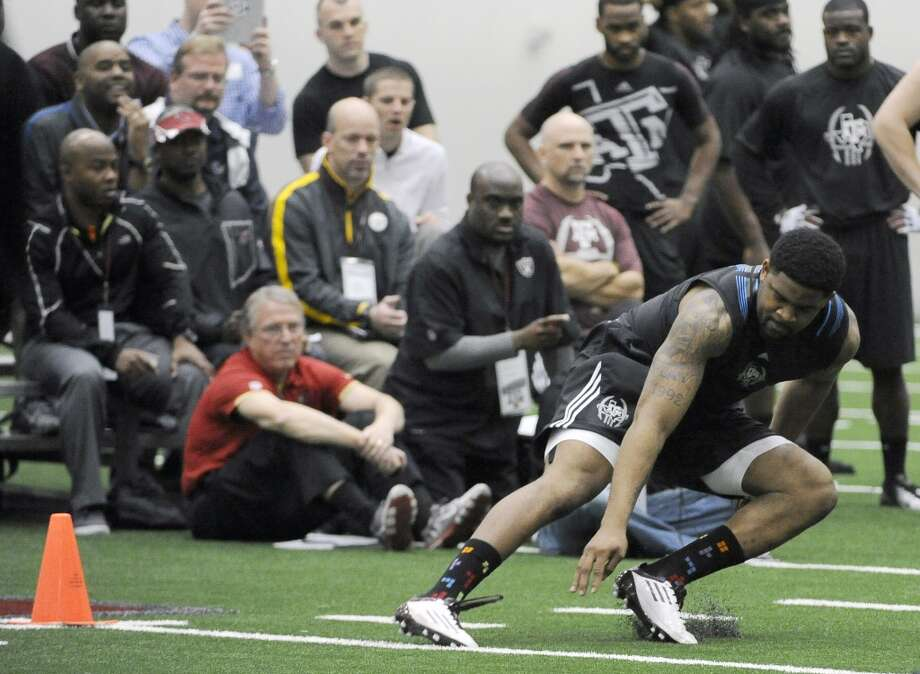Texas A&M's Damontre Moore runs a drill for NFL scouts on NFL Pro Day, Friday, March 8, 2013 in College Station, Texas. (AP Photo/Pat Sullivan) Photo: Pat Sullivan, Associated Press