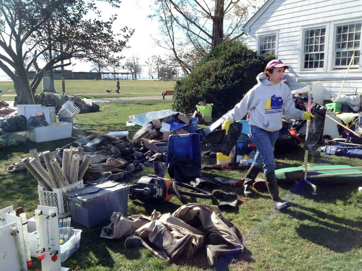 SoundWaters Executive Director Leigh Shemitz pitches in to help clean up the educational organization's facility on Cove Island Park in Stamford, on Wednesday, Oct. 31, 2012, following Hurricane Sandy.