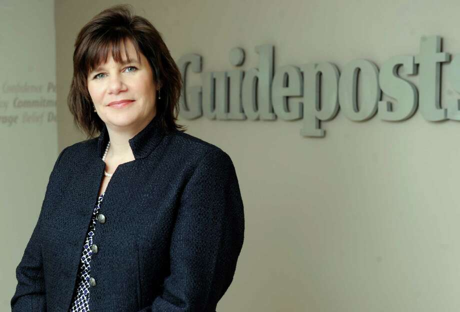 Kelly Fermo Mangold, of Brookfield, Conn., is senior vice president of Guideposts, located at the Matrix Corporate Center in Danbury, Conn. Wednesday, March 19, 2014. Photo: Carol Kaliff / The News-Times