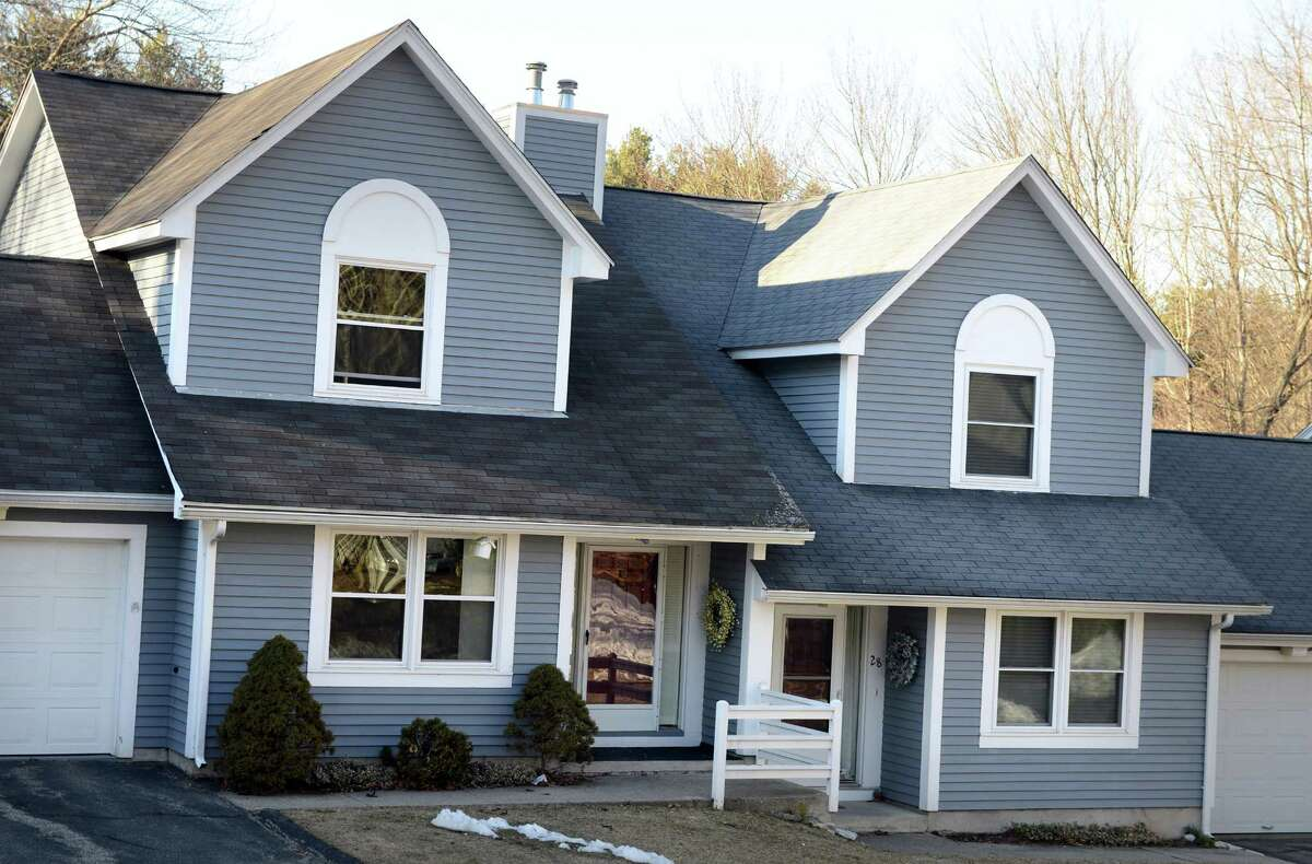 A townhome at 28 Meadow Lake Drive in Shelton, Conn., the unit on the right, recently sold through a short sale.