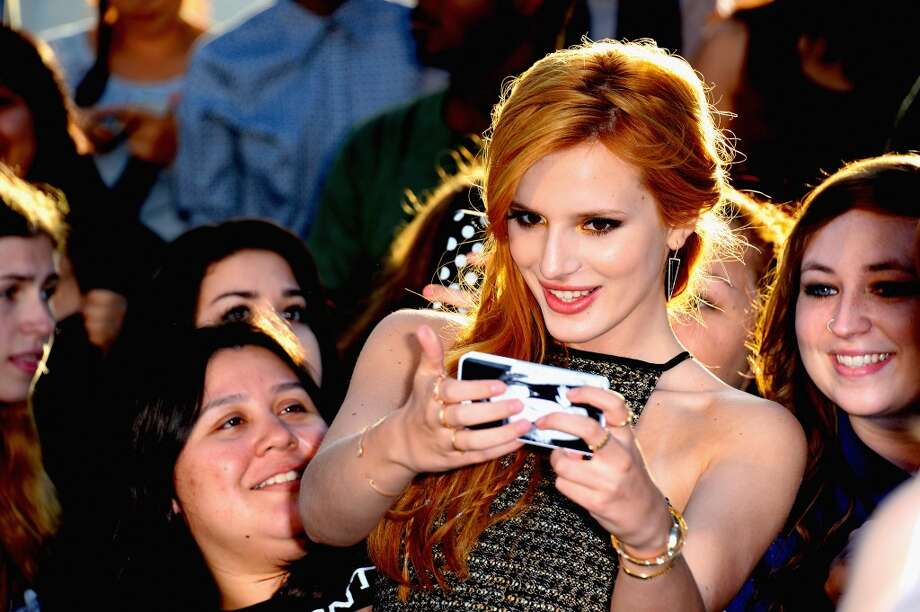 Actress Bella Thorne arrives at the premiere Of Summit Entertainment's 'Divergent' at Regency Bruin Theatre on March 18, 2014 in Los Angeles, California. Photo: Frazer Harrison, Getty Images