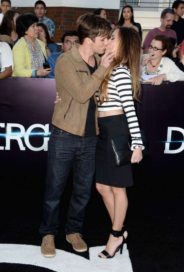 "Actor Matt Lanter and Angela Stacy arrive at the premiere of Summit Entertainment's ""Divergent"" at the Regency Bruin Theatre on March 18, 2014 in Los Angeles, California. Photo: Frazer Harrison, Getty Images"