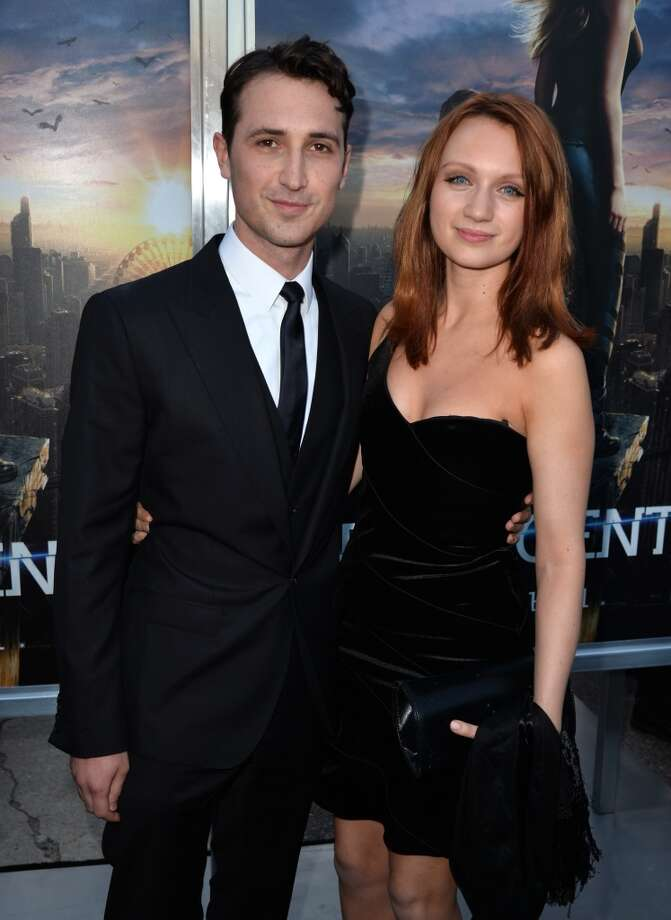 "Actors Ben Lloyd-Hughes (L) and Emily Berrington arrive at the premiere of Summit Entertainment's ""Divergent"" at the Regency Bruin Theatre on March 18, 2014 in Los Angeles, California. Photo: Kevin Winter, Getty Images"