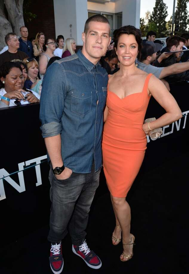 "Actors Greg Finley (L) and Bellamy Young arrive at the premiere of Summit Entertainment's ""Divergent"" at the Regency Bruin Theatre on March 18, 2014 in Los Angeles, California. Photo: Kevin Winter, Getty Images"