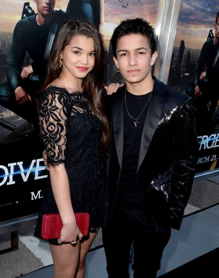 "Actors Paris Bereic (L) and Aramis Knight arrive at the premiere of Summit Entertainment's ""Divergent"" at the Regency Bruin Theatre on March 18, 2014 in Los Angeles, California. Photo: Kevin Winter, Getty Images"