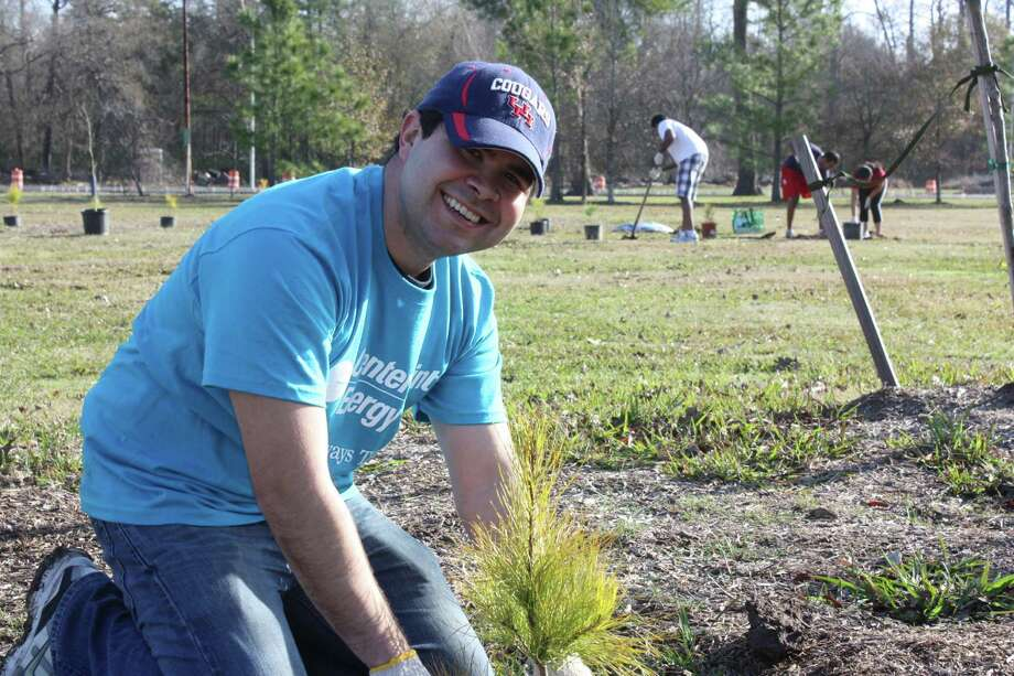 Francisco Almazon plants a tree as part of CenterPoint Energy's Right Tree Right Place project.