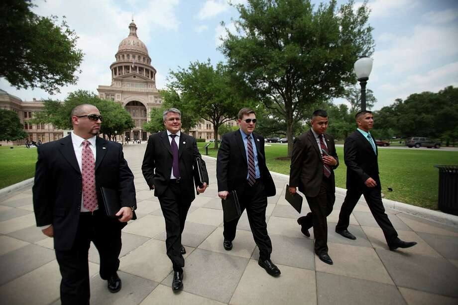 "Veterans Jason Williams, Kevin Barber, John Boerstler, Eduardo Rodriguez, and Marty Gonzalez, walk out of the Texas State Capitol after a 2011 lobbying effort in Austin.  Kevin Barber's business, Veteran Energy helps  Texas veterans, active-duty military and their families through its ""Power to Give Back Program."" Photo: Mayra Beltran, Staff / Houston Chronicle"