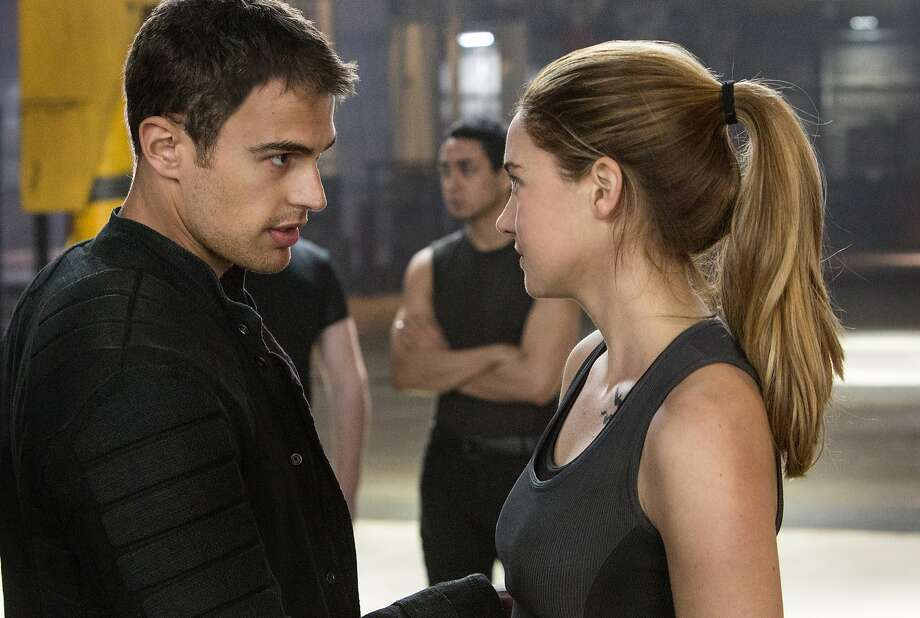 "It's the future, and society is divided into neat categories with no room for those who don't fit tidily into one of them. Theo James and Shailene Woodley deal with it in ""Divergent."" Photo: Jaap Buitendijk, Summit Entertainment"