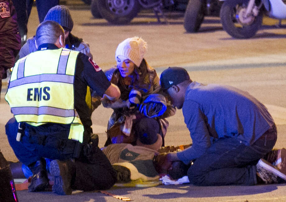 A victim of a car crash during South by Southwest in Austin is helped. For those who wonder if SXSW has shed its innocence, they should, instead, look to those bringing in bad behaviors. Photo: Jay Janner / Associated Press / Austin American-Statesman