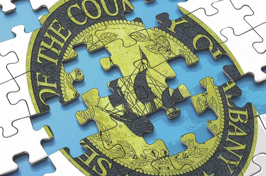 Missing puzzle pieces of Albany County seal. Photo Illustration by Tyswan Stewart / Times Union / tadamichi - Fotolia