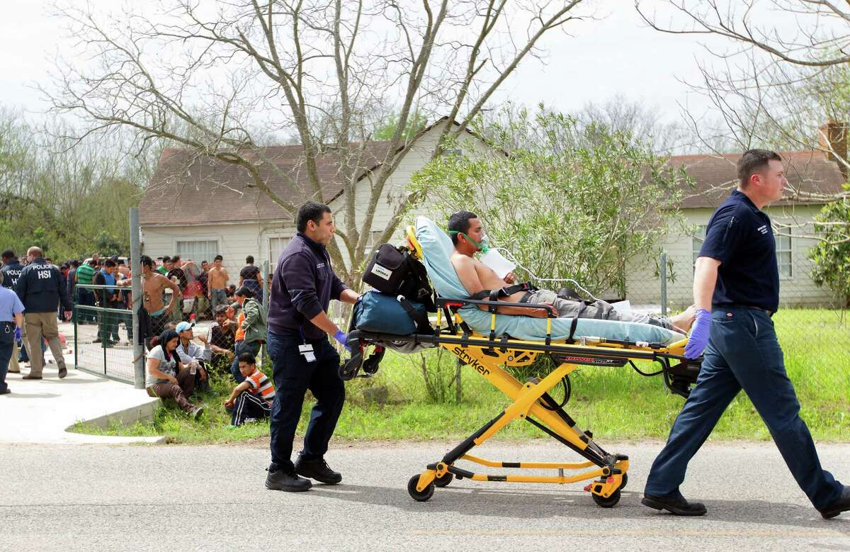 """More than 100 people were found Wednesday morning inside a house at 14711 Almeda School Road in Southeast Houston, Wednesday, March 19, 2014. Police found the group, who are all presumed to be in the country illegally -- at a squalid """"stash house"""" in southeast Houston. Police say it appears to be human smuggling operation."""