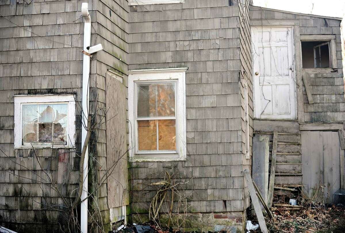In this file photo, an abandoned house on Catoonah Street in Ridgefield, Conn. was mentioned at a hearing on the towns anti-blight laws in January.