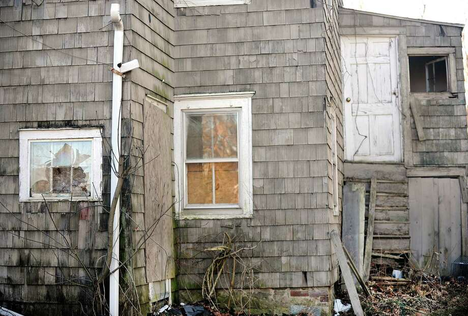 In this file photo, an abandoned house on Catoonah Street in Ridgefield, Conn. was mentioned at a hearing on the towns anti-blight laws in January. Photo: Cathy Zuraw / The News-Times