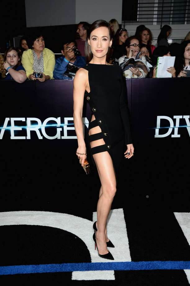 "Actress Maggie Q arrives at the premiere of Summit Entertainment's ""Divergent"" at the Regency Bruin Theatre on March 18, 2014 in Los Angeles, California. Photo: Frazer Harrison, Getty Images"