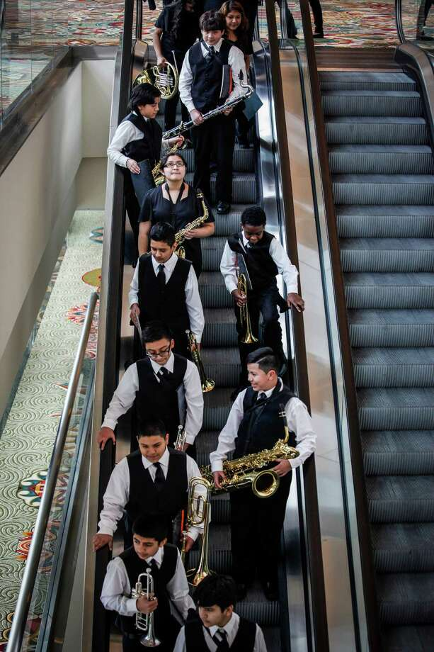 Student musicians exit the fourth floor before HISD Superintendent Terry Grier delivers his annual State of the Schools address Feb. 26, 2014 in Houston.  (Eric Kayne/For the Chronicle) Photo: Eric Kayne / Eric Kayne