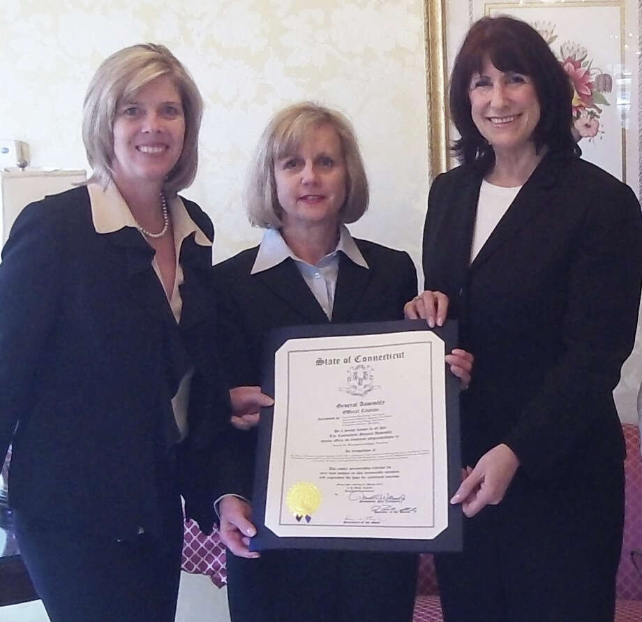 Funeral home owner Pamala Shaughnessey-Banks is presented the Womenís Economic Spotlight Recognition Award by state Rep. Kim Fawcett, left, and Beverly Balaz, executive director of the fairfield Chamber of Commerce. The award, given periodically, aims to spotlight successful business women in town. Photo: Fairfield Citizen/Contributed / Fairfield Citizen