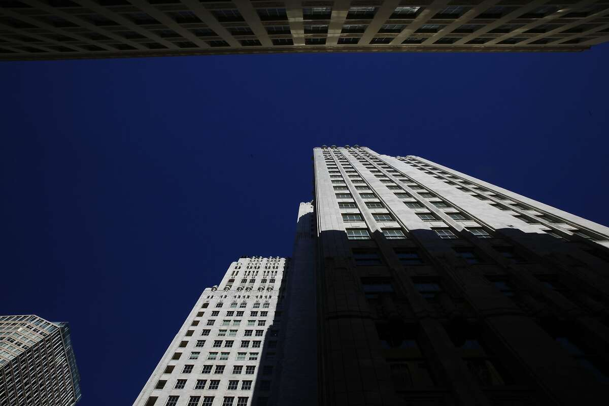 The top of 140 New Montgomery Street (bottom) is seen with the tops of other neighboring buildings on Tuesday, March 18, 2014, in San Francisco, Calif.