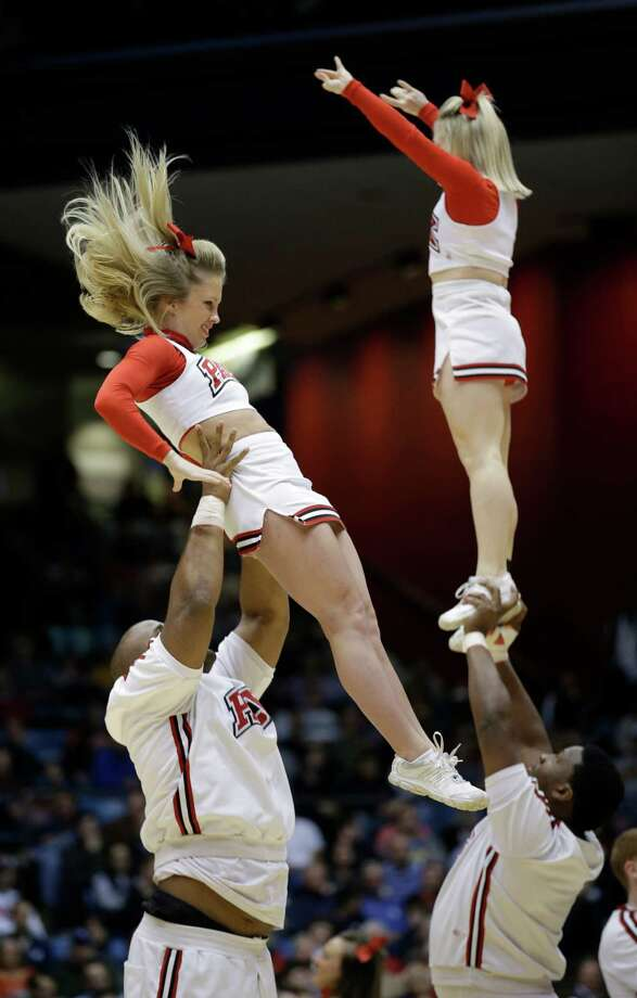 North Carolina State cheerleaders perform in the second half of a first-round game against Xavier at the NCAA college basketball tournament, Tuesday, March 18, 2014, in Dayton, Ohio. (AP Photo/Al Behrman) Photo: Al Behrman, Associated Press / AP