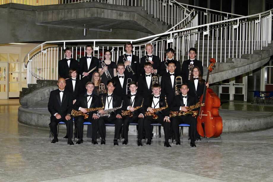 "All jazzed up for Saturday's ""Essentially Ellington"" concert are Greenwich High School band members (top row, from left) Tim Prier, John McCormack, Jackie Bein, Doug Wrotnowski, Tommy Glover, Kotaro Yamashiro and  Nikhil Mandava;  (middle row, from left) Lucas Mangold, Mia Costanzo, Ben Albano, Paul Collins, Aaron Kim and Chris Healy; (bottom row, from left) the band's music director Mr. John Yoon, Vince Urbanowski, Christian Lee, Trevor Kelly, Peter Russell and Stephen Aly. Photo: Contributed Photo / Greenwich Time Contributed"